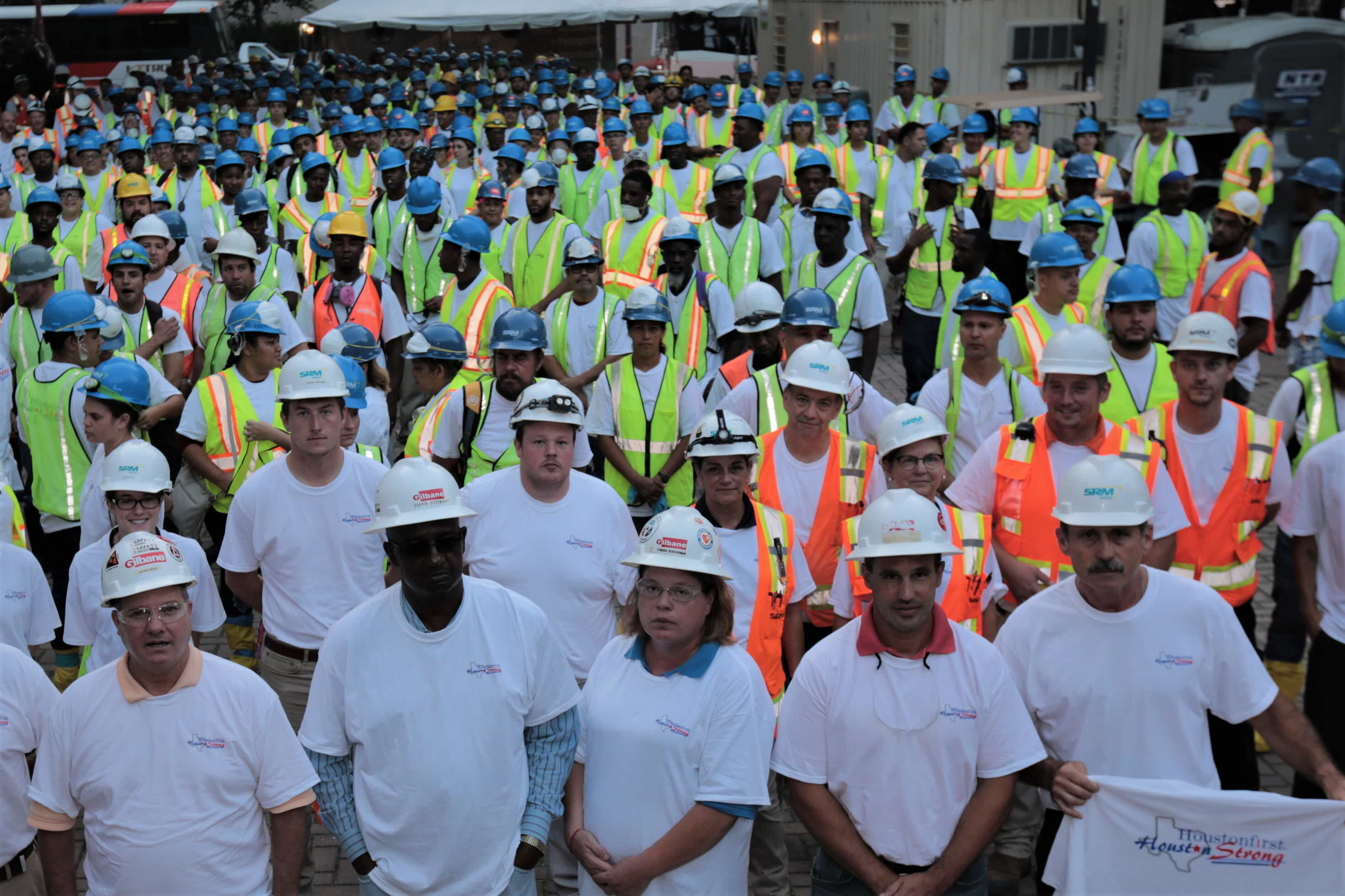group shot of people wearing hard hats
